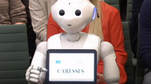AI could transform care for older people, robot tells MPs
